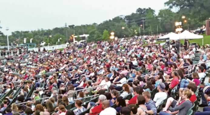 a full audience at the Cascades Park amphitheater during a Southern Shakespeare Company performance